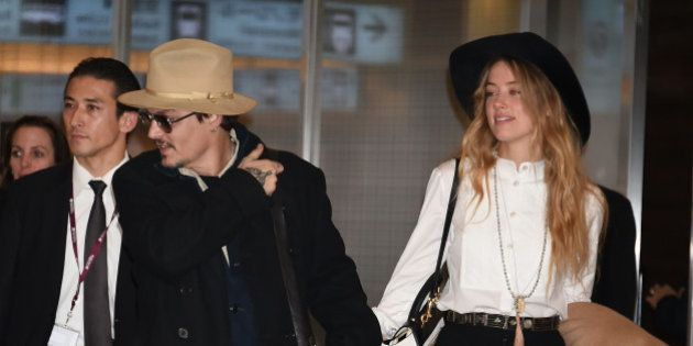 TOKYO, JAPAN - JANUARY 26: Johnny Depp and Amber Heard are seen upon arrival at Haneda Airport on January...