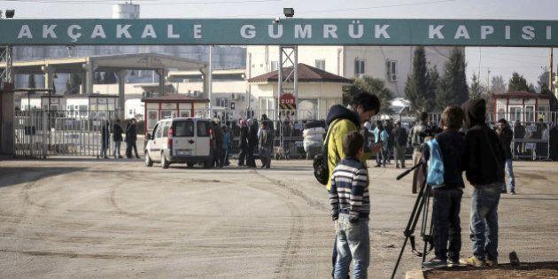 SANLIURFA, TURKEY - JANUARY 29: Journalists are seen at the Akcakale customs gate in Sanliurfa, southeastern...