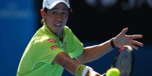 MELBOURNE, AUSTRALIA - JANUARY 28: Kei Nishikori of Japan plays a backhand in his quarterfinal match...