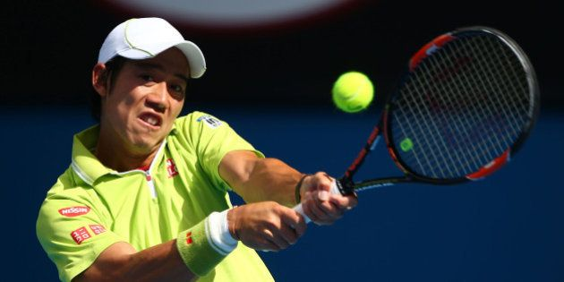 MELBOURNE, AUSTRALIA - JANUARY 26: Kei Nishikori of Japan plays a backhand in his fourth round match...