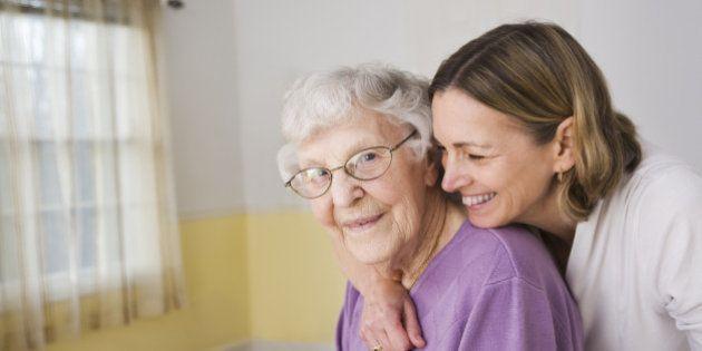 Daughter hugging Elderly