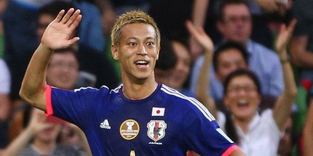 MELBOURNE, AUSTRALIA - JANUARY 20: Keisuke Honda of Japan celebrates after he scored a goal during the...