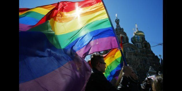 FILE - In this Wednesday, May 1, 2013, file photo, gay rights activists carry rainbow flags as they march...