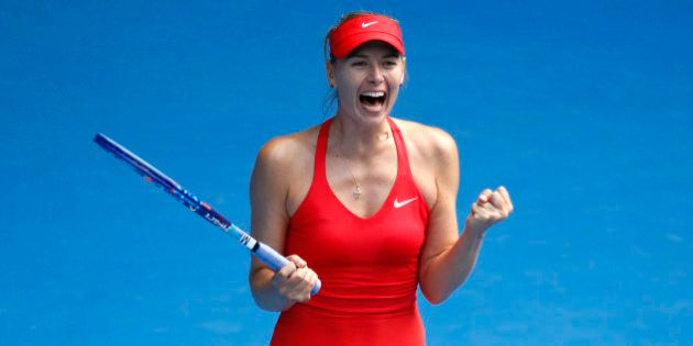 Maria Sharapova of Russia celebrates after defeating her compatriot Ekaterina Makarova in their semifinal...