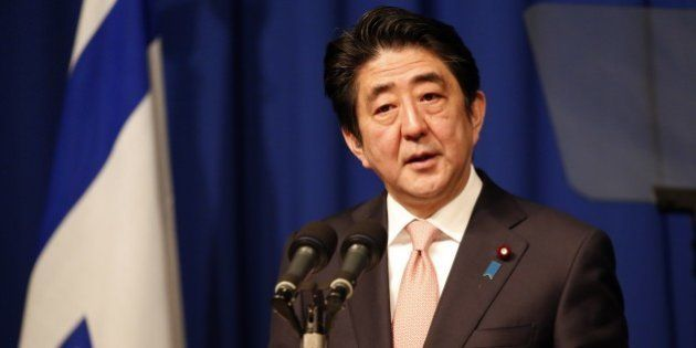 Japanese Prime Minister Shinzo Abe speaks during a press conference at a hotel in Jerusalem on January...