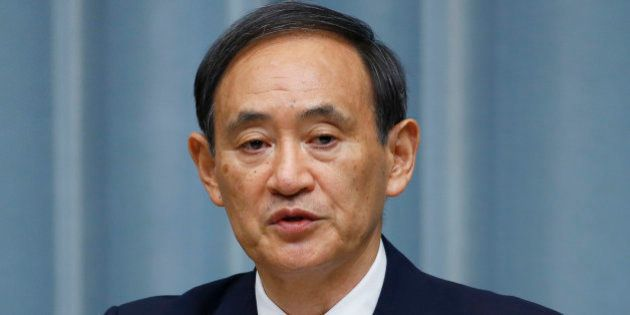 Japan's Chief Cabinet Secretary Yoshihide Suga unveils a new lineup of Prime Minister Shinzo Abe's Cabinet...