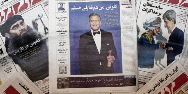 A picture taken in Tehran shows copies of the headline of Iranian reformist newspaper Mardom-e Emrouz...