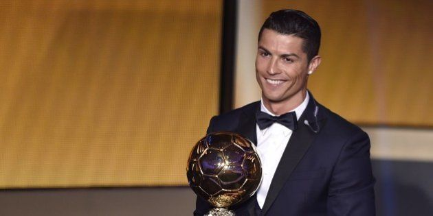Real Madrid and Portugal forward Cristiano Ronaldo smiles after receiving the 2014 FIFA Ballon d'Or award...
