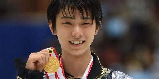 NAGANO, JAPAN - DECEMBER 27: Yuzuru Hanyu of Japan (Gold) poses with his gold medal in the award ceremony...