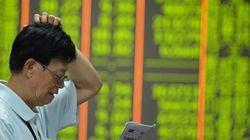 中国株が大幅続落、上海総合指数はパニック売りで8.5%安 今年の上昇分をすべて失う