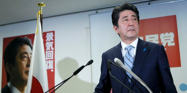 Shinzo Abe, Japan's prime minister and president of the ruling Liberal Democratic Party (LDP), stands...
