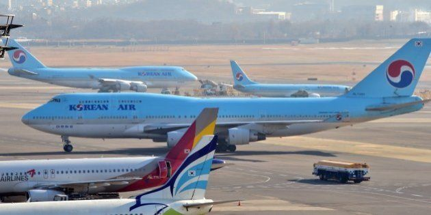 South Korea's Korean Air plane (C) sits on the tarmac at Gimpo airport in Seoul on December 9, 2014....