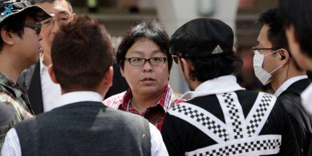 In this photo taken Sunday, May 12, 2013, Makoto Sakurai, center, leader of anti-Korean activist group...