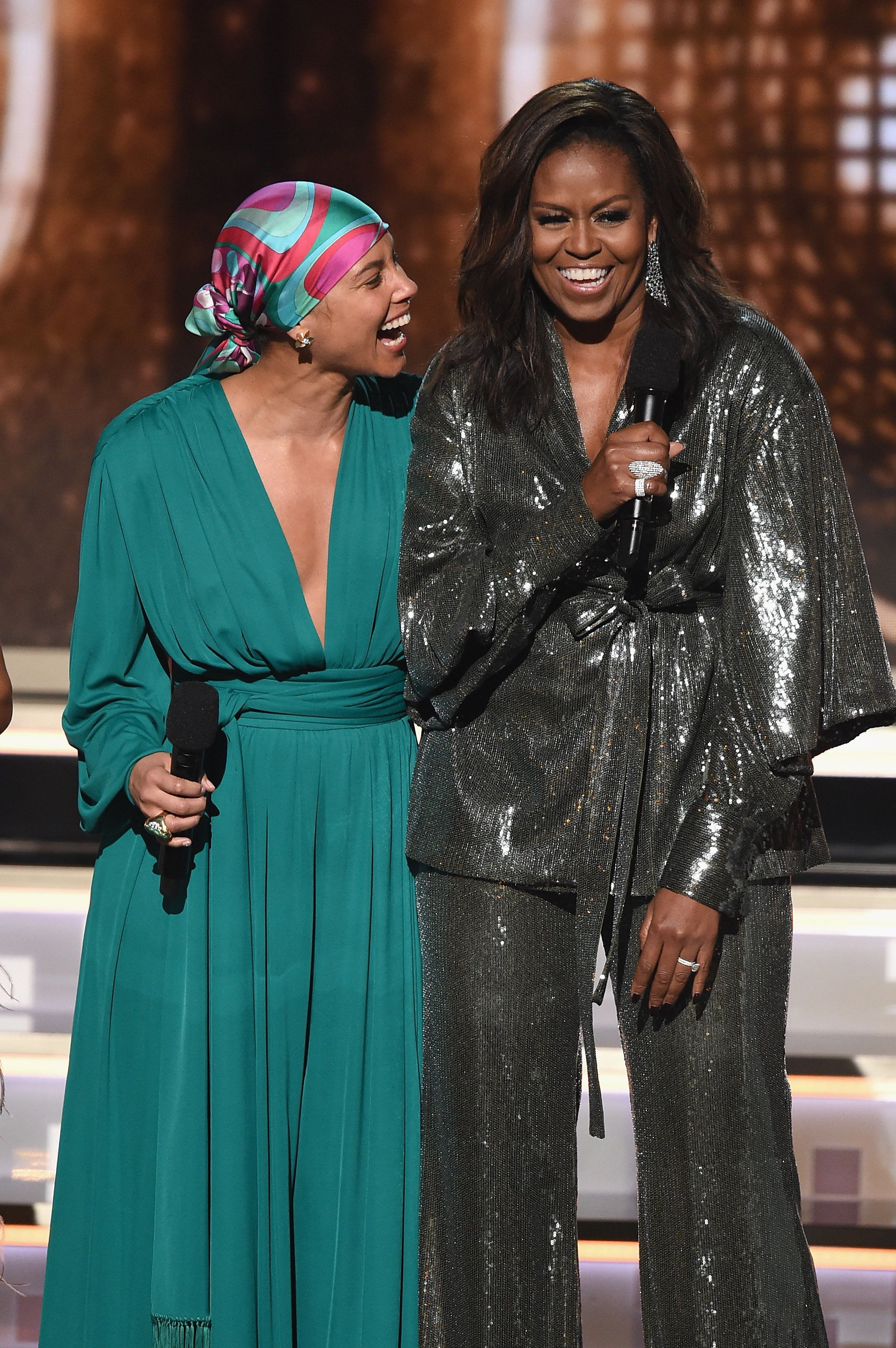 LOS ANGELES, CA - FEBRUARY 10:  Alicia Keys (L) and Michelle Obama speak during the 61st Annual GRAMMY Awards at Staples Center on February 10, 2019 in Los Angeles, California.  (Photo by Kevin Winter/Getty Images for The Recording Academy)