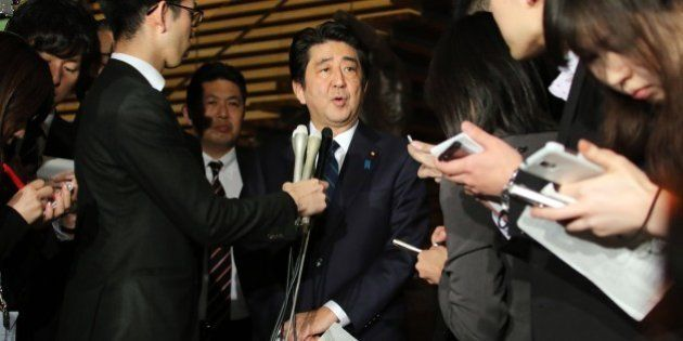 Japanese Prime Minister Shinzo Abe speakes to reporters after a cabinet meeting at his official residence...