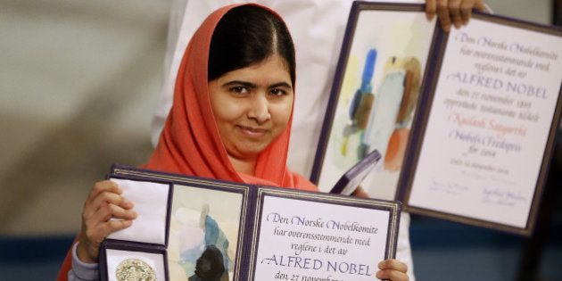 Nobel Peace Prize winners Malala Yousafzai from Pakistan, front, and Kailash Satyarthi of India are awarded...