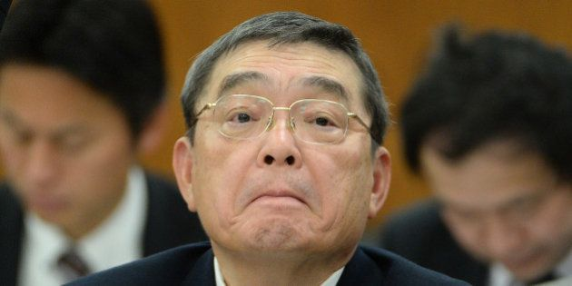 Katsuto Momii, president of Japan's NHK, listens to questions at the National Diet of parliament in Tokyo...