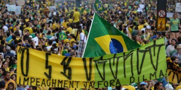 Demonstrators rally to protest against the government of president Dilma Rousseff in Paulista Avenue...