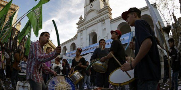 Demonstrators bang their bass drums during a demonstration at Plaza de Mayo square in Buenos Aires on...
