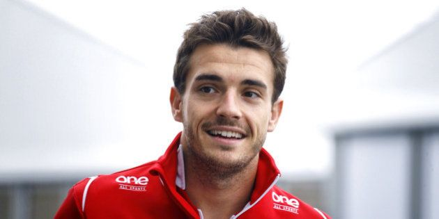 SUZUKA, JAPAN - OCTOBER 05: Jules Bianchi of France and Marussia arrives for the drivers' parade prior...
