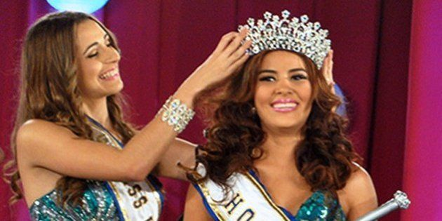 (FILES) Undated picture taken in San Pedro Sula of Maria Jose Alvarado (R), Miss Honduras World, whose...
