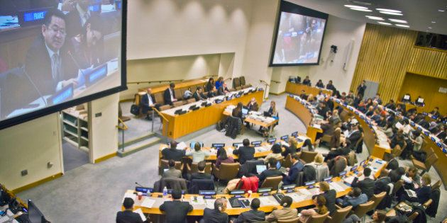 Large screen monitors broadcast Choe Myong Nam, North Korea's official in charge of U.N. affairs and...