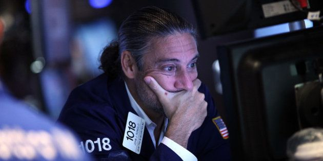 NEW YORK, NY - AUGUST 24: A trader works on the floor of the New York Stock Exchange (NYSE) on August...
