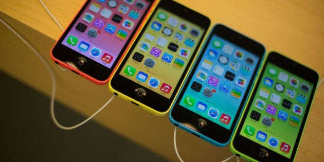 HONG KONG - SEPTEMBER 20: The new iPhone 5C is displayed inside Apple's store in Causeway Bay district...