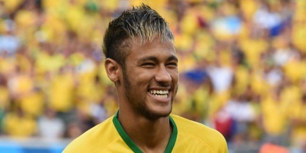 Brazil's forward Neymar smiles before the quarter-final football match between Brazil and Colombia at...