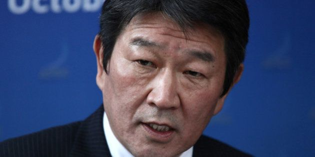 Toshimitsu Motegi, Japan's minister of economy, trade and industry, speaks during a news conference following...