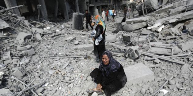A Palestinian woman reacts at seeing destroyed homes in the northern district of Beit Hanun in the Gaza...