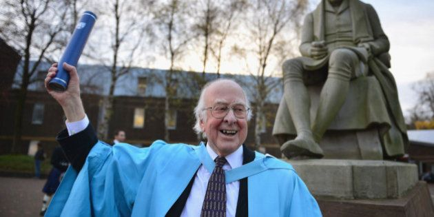 EDINBURGH, SCOTLAND - NOVEMBER 16: Professor Peter Higgs, poses for photographs in front of a statue...