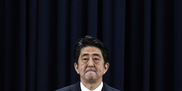 Japan's Prime Minister Shinzo Abe gives a press conference during the Asia-Pacific Economic Cooperation...