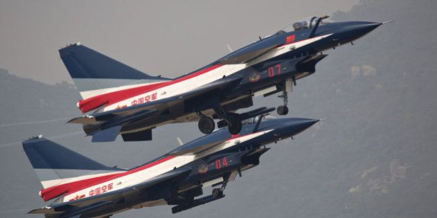 ZHUHAI, CHINA - NOVEMBER 11: (CHINA OUT) J10 perform in the air during the 10th China International Aviation...