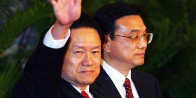 BEIJING - OCTOBER 22: Zhou Yongkang, one of the new nine-seat Politburo Standing Committee, greets the...
