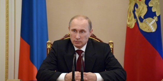 Russia's President Vladimir Putin chairs a Security Council meeting in the Kremlin in Moscow, on July...