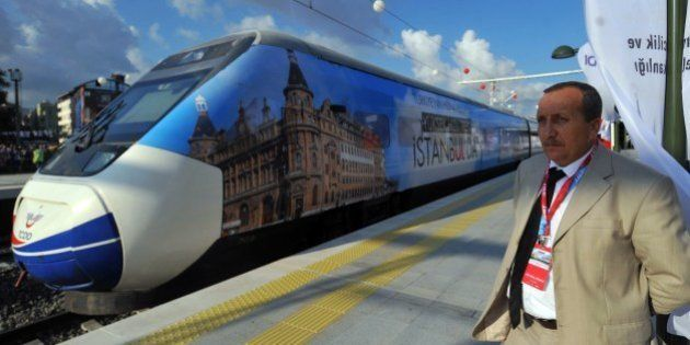 A man stands by the first Turkish high-speed train at Pendik railway station, in Istanbul, during the...