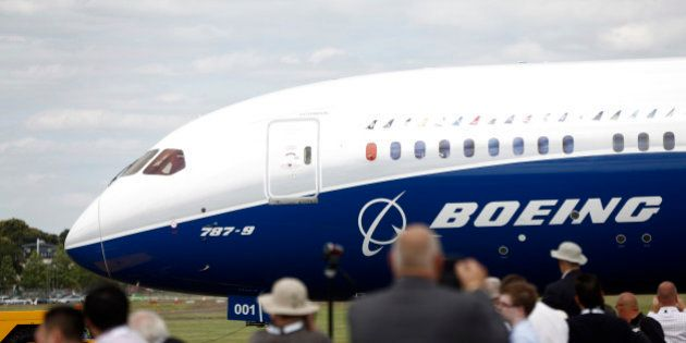 Visitors watch as a Boeing 787-9 Dreamliner aircraft, produced by Boeing Co., taxis on the runway before...