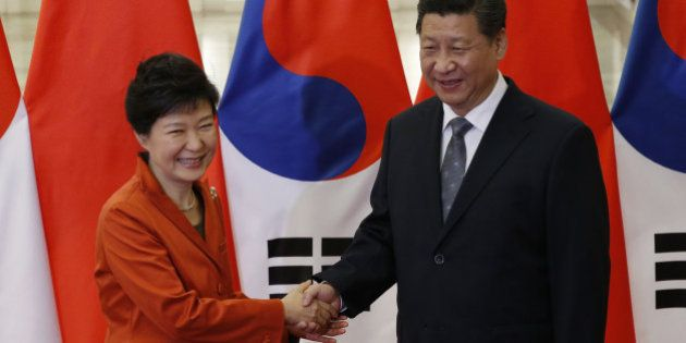BEIJING, CHINA - NOVEMBER 10: China's President Xi Jinping (R) shakes hands with South Korea's President...
