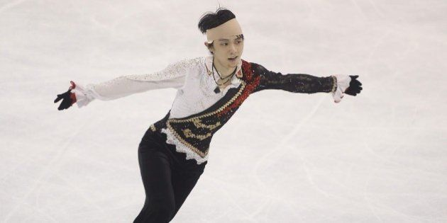 Japanese skater Yuzuru Hanyu, seen wearing a bandage to his head after colliding with Yan Han of China...
