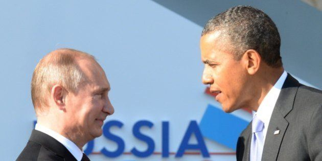 Russias President Vladimir Putin (L) welcomes US President Barack Obama at the start of the G20 summit...