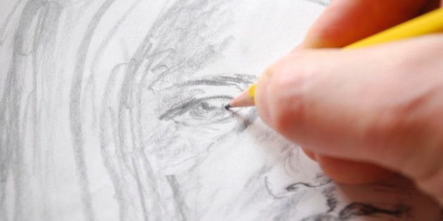 A hand is drawing A portrait of a