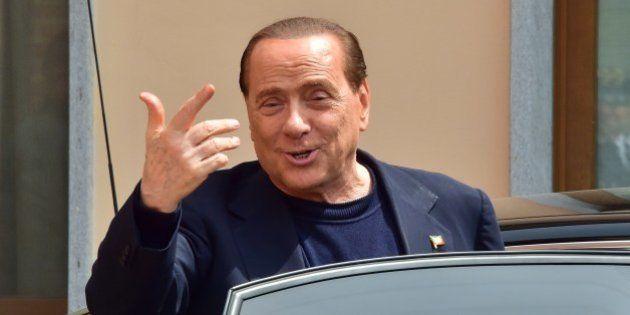 Italian former Prime Minister Silvio Berlusconi leaves the Catholic hospice 'Sacra Famiglia' (Holy Family...