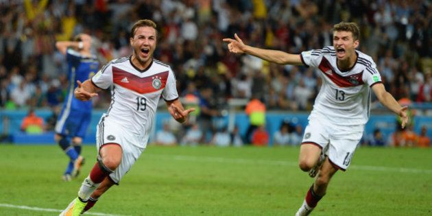 RIO DE JANEIRO, BRAZIL - JULY 13: Mario Goetze of Germany (L) celebrates scoring his team's first goal...