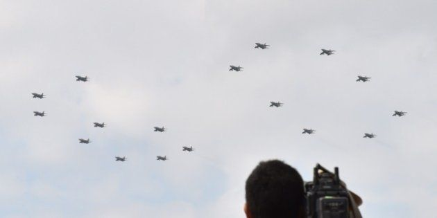 Military jet planes perform a flying formation of the number '60' to commemorate the 60th anniversary...