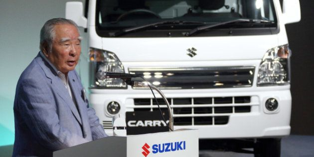 Osamu Suzuki, chairman, president and chief executive officer of Suzuki Motor Corp., speaks at the unveiling...