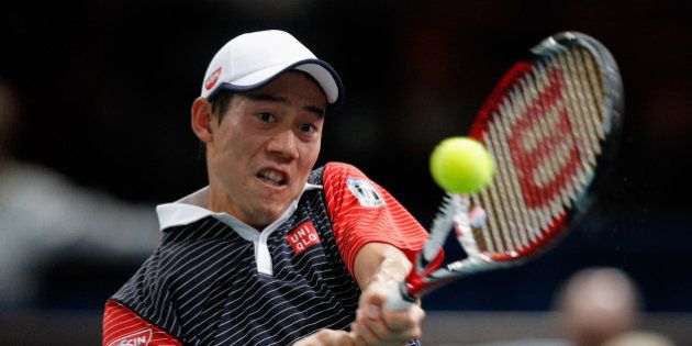 PARIS, FRANCE - OCTOBER 31: Kei Nishikori of Japan in action against David Ferrer of Spain in their quarterfinal...