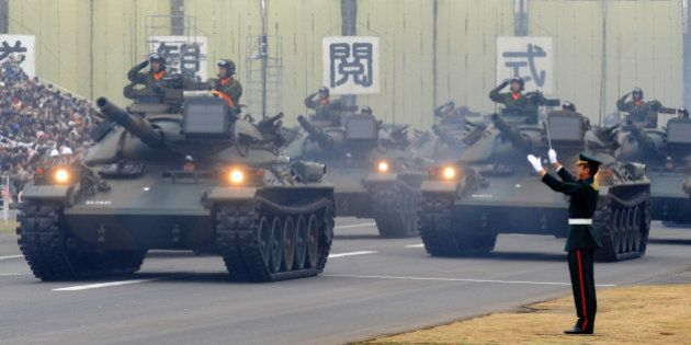A tank unit takes part in an inspection parade at the Asaka base in suburban Tokyo on October 24, 2010....