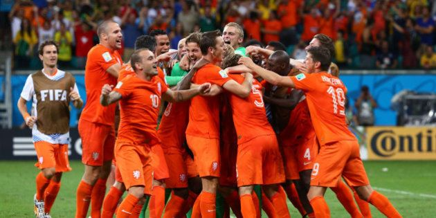 SALVADOR, BRAZIL - JULY 05: Goalkeeper Tim Krul of the Netherlands celebrates with teammates after making...