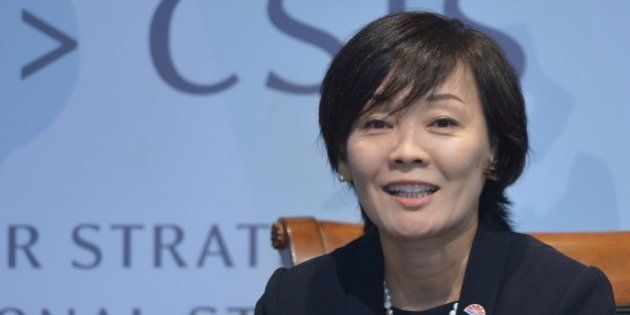 Akie Abe, the wife of Japan's Prime Minister Shinzo Abe, answers aquestion during a discussion on 'Womenomics:...